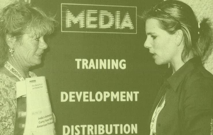 Suzanne Meltzer, public affairs coordinator for The Marketplace (left) confers with Helen Danielson, producer.