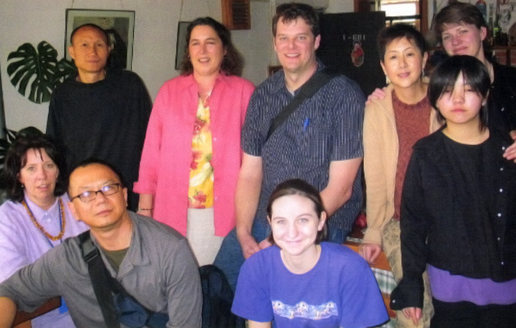At the home of filmmaker Liu Xiaojin in Kumming. Back row, left to right: Liu Xiaolin's husband, Mao Xuhei; Mimi Pickering; Greg Howard; Liu Xiaojin and her daughter, Momo; Maureen Mullinax, Front row, left to right: Elizabeth Barret; Somi Roy; Barret's daughter, Ada. Photo courtesy of L. Somi Roy.