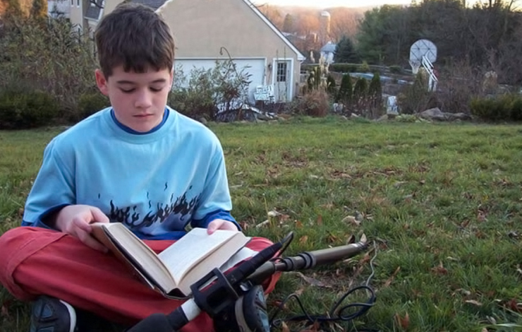 A second generation 'Stone Reader,' the director's son, Emmett Moskowitz, reads a book during production of 'Stone Reader.' Photo: Robert Goodman, courtesy of JET Films, LLC.