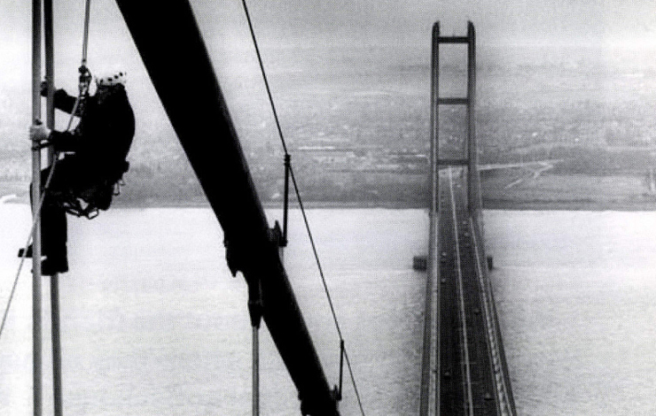 John Williams, a structural surveyor, high atop the Hull Bridge, from a Dr. Marten's commercial shot by Doug Pray. Photo: Charles Peterson