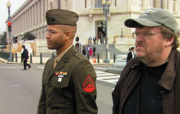 Michael Moore and Sgt. Abdul Henderson on Capitol Hill attempting to convince congressmen to send their sons to Iraq. From Michael Moore's <em> Fahrenheit 9/11</em>. Photo: Dog Eat Dog Films