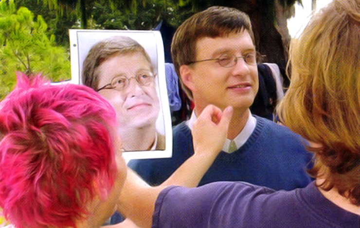 Steve Sires' resemblance to Bill Gates is polished and made ready for the camera by director Brian Flemming on the set of the film 'Nothing So Strange.'