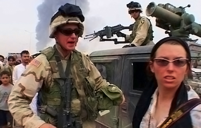 Stephanie Sinclair (right), a photojournalist for the Chicago Tribune. Photo from <em> War Feels Like War</em>, which appeared on PBS's P.O.V. in Julu. Photo: Uyarra Films.