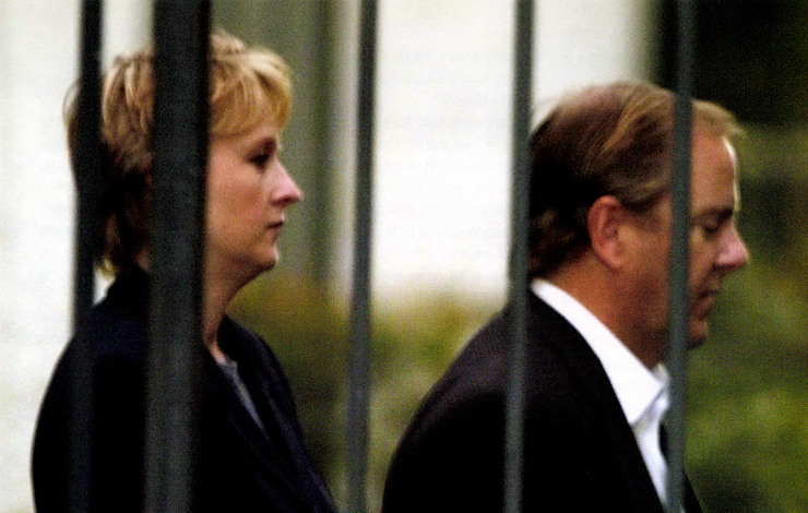A handcuffed Jeffrey Skilling (right), former president of Enron, is escorted from FBI headquarters in Houston by an unidentified agent on Thursday, February 19, 2004 after surrendering to face criminal charges related to the company's collapse. From Alex Gibney's 'Enron: The Smartest Guys in the Room.' Photo: Pat Sullivan/AP