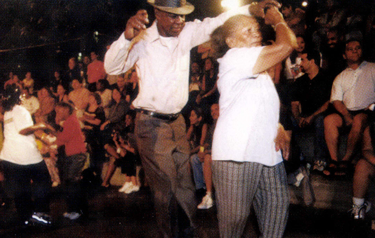 Old timers dance at PS 52 reunion concert in the South Bronx, New Yorl. From Henry Chalfant's From 'Mambo to Hip Hop.' Photo: Martha Cooper