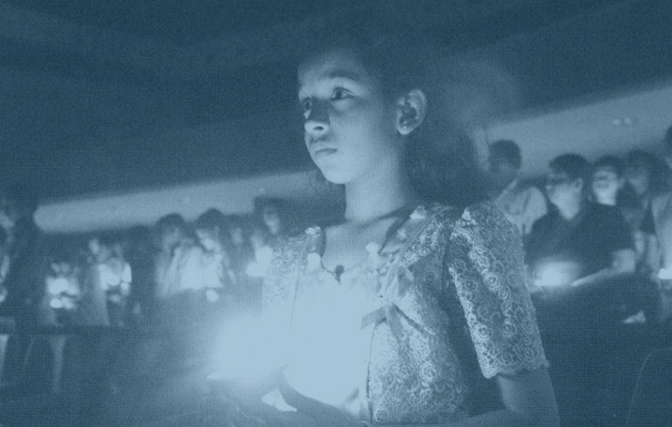 A young Sri Lankan girl takes part in a candlelight memorial for AIDS victims. From the Frontline documentary 'The Age of AIDS.'