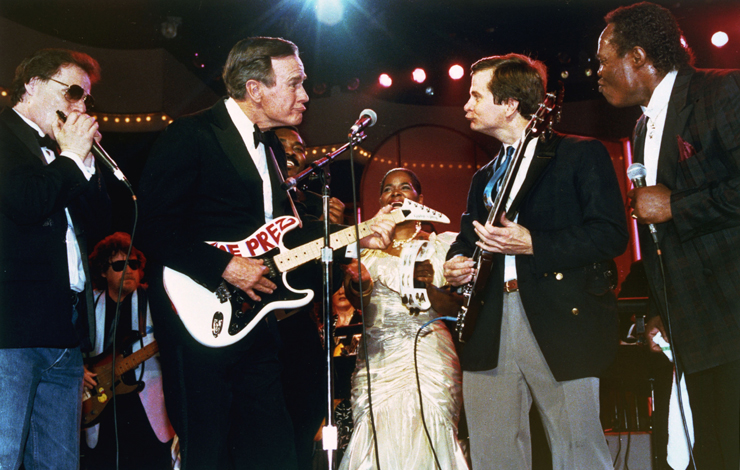 US President George Bush (left) trades looks with Lee Atwater, chairman of the Republican National Committe, as they accompany a blues band at inaugural Ball in Washington DC, on January 21, 1989. From Stefan Forbes' <em>Boogie Man: The Lee Atwater Story</em>