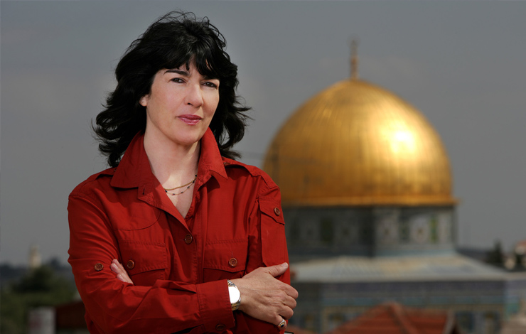 Christiane Amanpour stands in front of the Dome in the Rock in Jerusalem, Israel in February 2007. Photo: Brent Stirton/Getty Images for CNN