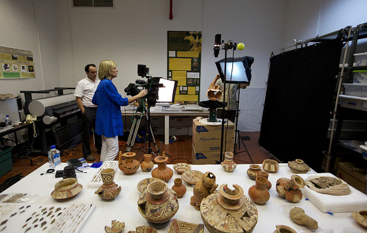 Filmmaker Maggie Burnette Stogner filming ancient artifacts in Panama for the <em>Indiana Jones and the Adventure of Archaeology </em>exhibition. Courtesy of Maggie Burnette Stogner