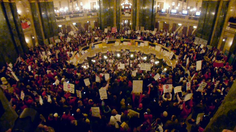 Protestors fill the rotunda in the Wisconsin State Capital in reponse to Governor Scott Walker's proposed anti-union bill. Courtesy of Variance Films/Elsewhere Films