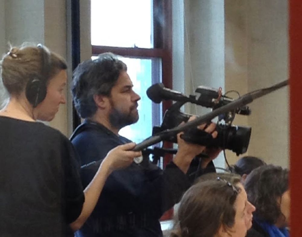 Katy Chevigny (left) and Ross Kuaffman filming at a Human Rights Watch event. Courtesy of Netflix