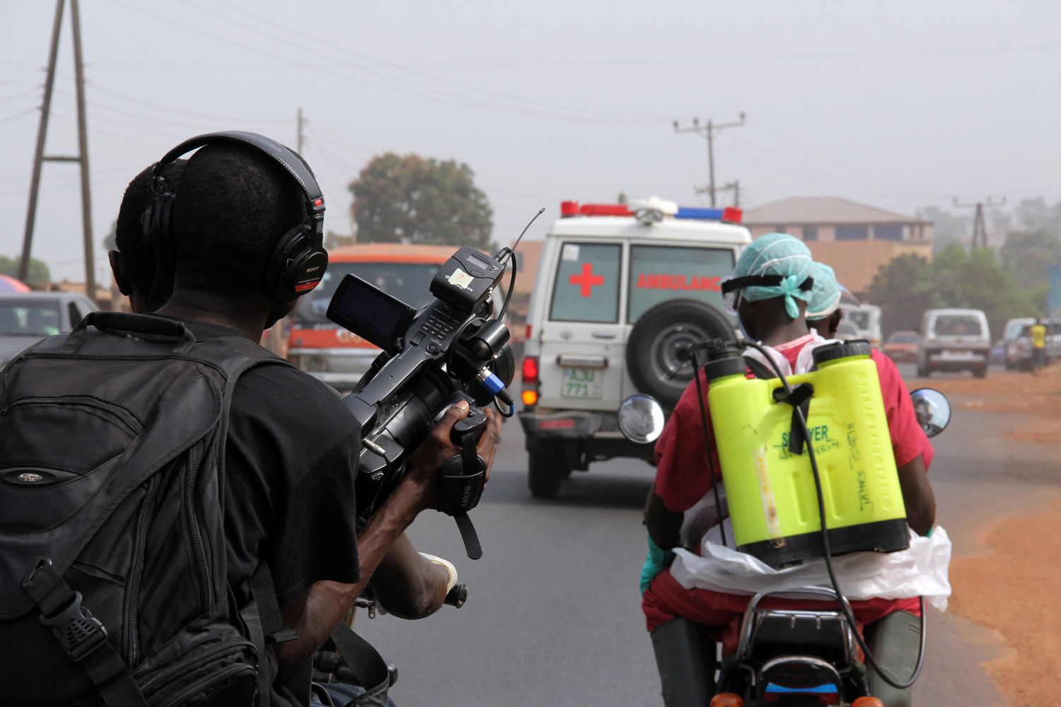 'Survivors' co-director Arthur Pratt holding camera on the back of an Okada. Courtesy of  WeOwnTV Freetown Media Center