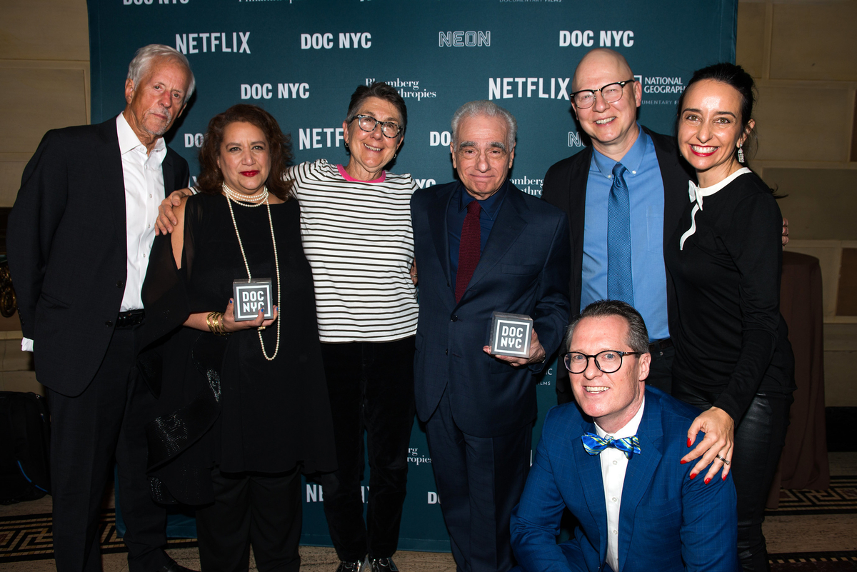 DOC NYC founders Rachaela Neihausen (top row, far right) and Thom Powers (bottom row, far right) with DOC NYC Visionaries.  Left to right: Michael Apted, Cynthia Lopez, Julia Reichert, Martin Scorsese, Steven Bognar, Raphaela Neihausen, Thom Powers. Courtesy of DOC NYC