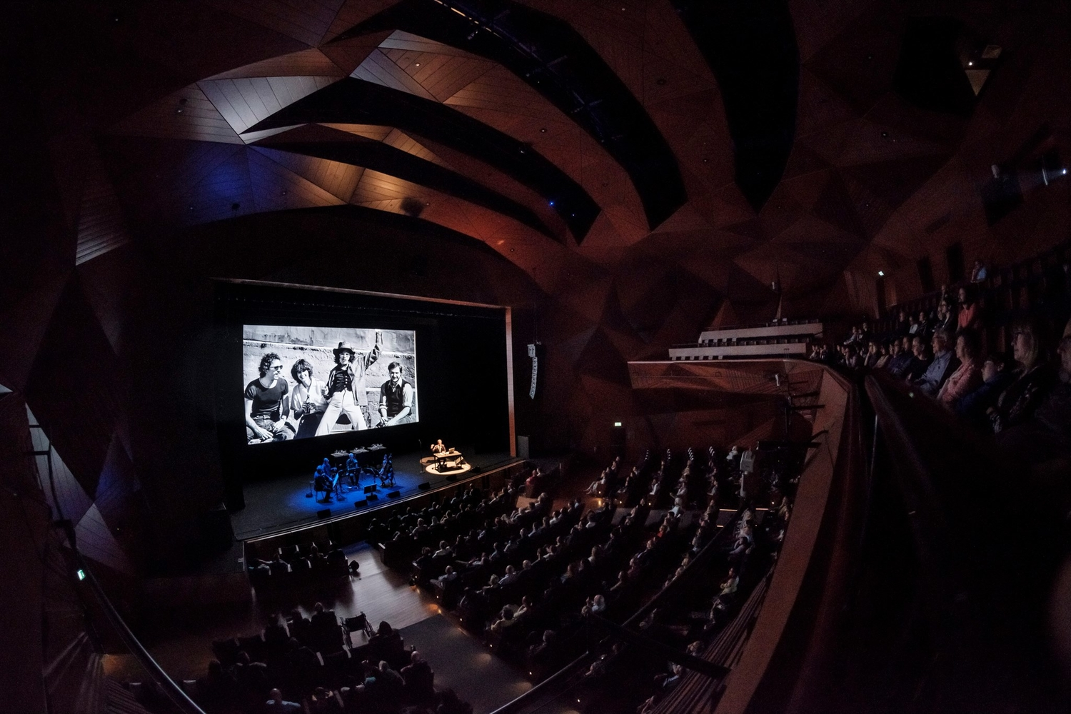 """The Kronos Quartet and Sam Green performing """"A Thousand Thoughts"""" at NYUAD Arts Center. Courtesy of NYUAD Arts Center"""