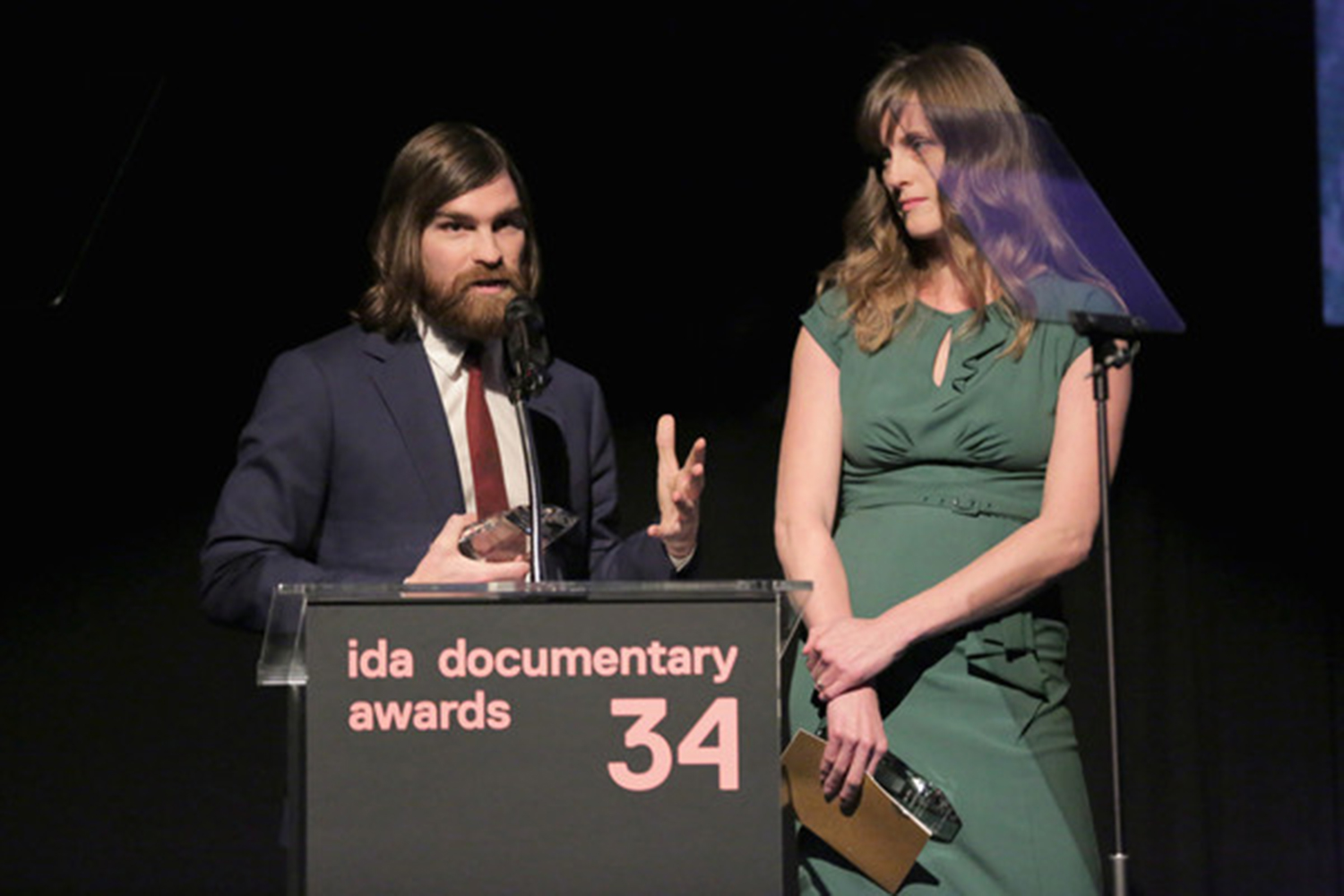 Andy Mills and Larissa Anderson, winners of the first Best Audio Documentary Award for 'Caliphate' speak onstage during the 2018 IDA Documentary Awards. Photo by Rebecca Sapp