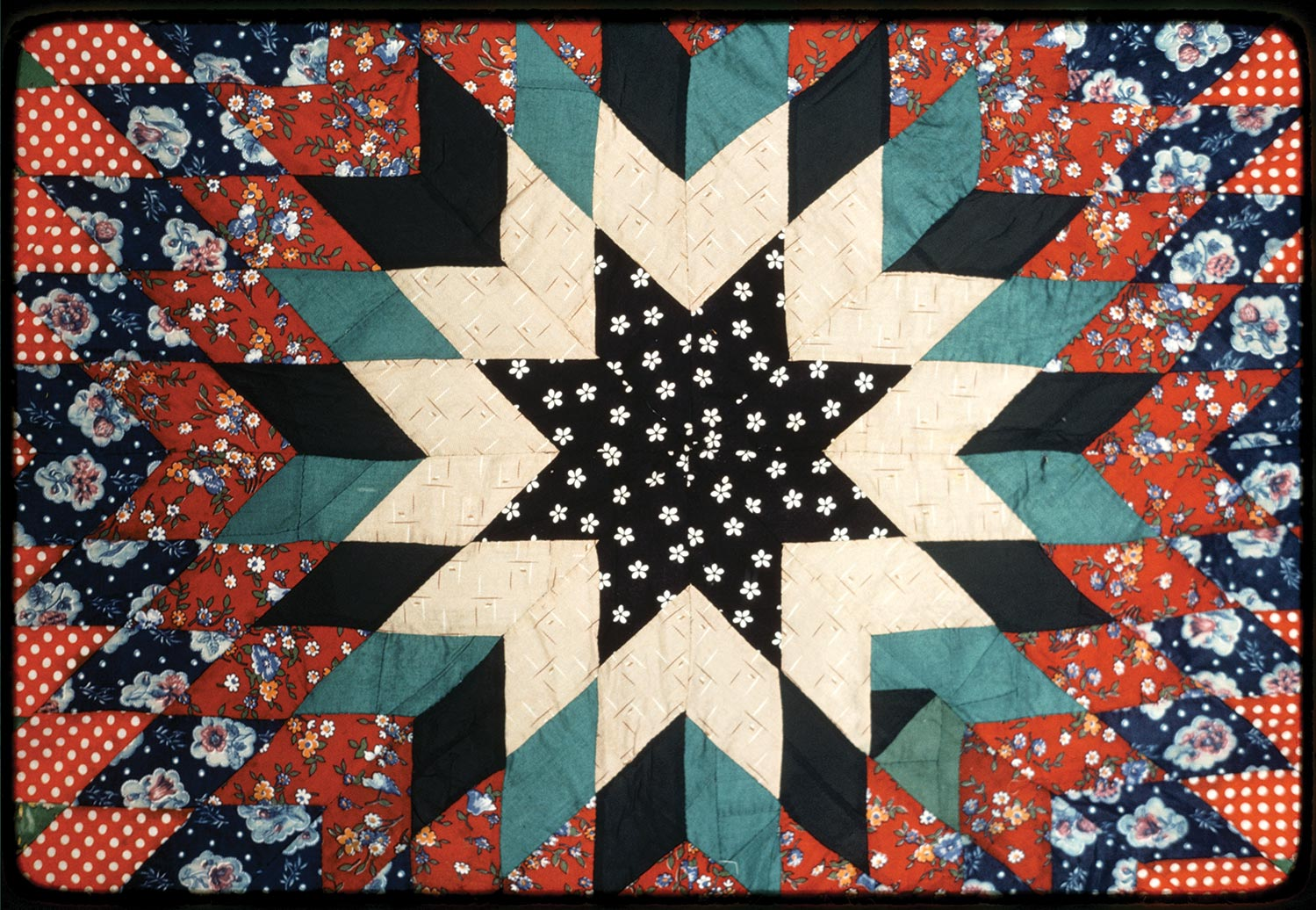 A Lone Star quilt created by Mrs. Sam T Smith. Photo by Geraldine Niva Johnson. Image retrieved from American Folklife Center at the Library of Congress.
