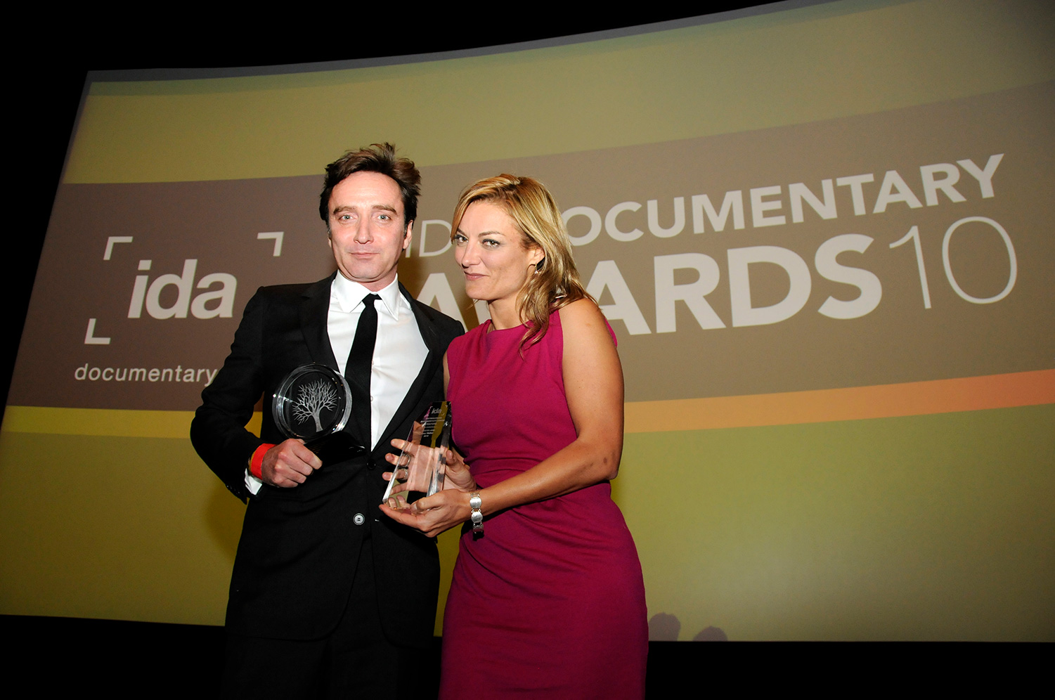 Filmmaker Lucy Walker and Producer Angus Aynsley accept the Pare Lorentz Award for 'Waste Land' at the 2010 Documentary Awards