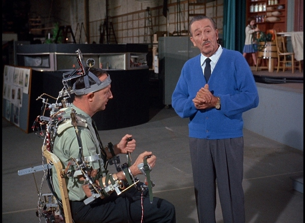 Walt Disney (right) with a Disney Imagineer, testing out animatronic gear. From Leslie Iwerks' 'The Imagineering Story.' Courtesy of Disney+