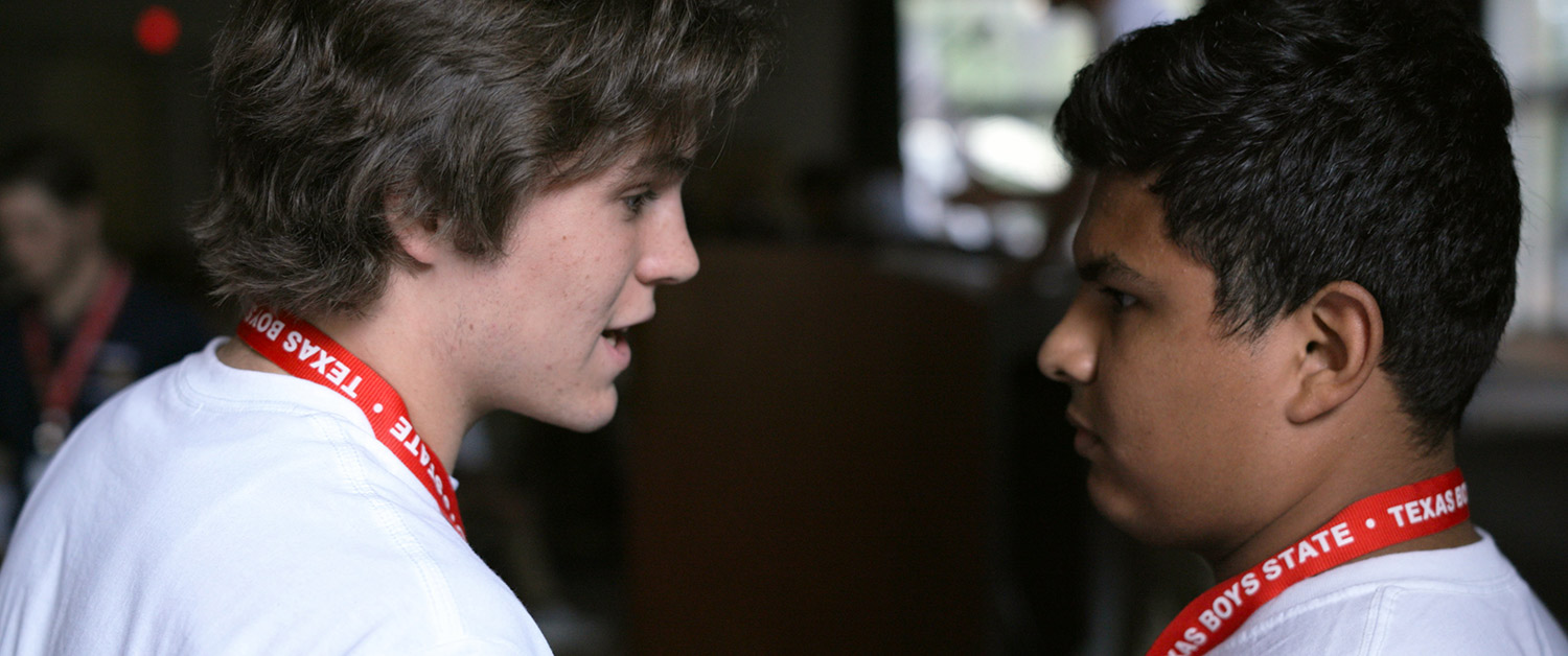 Robert MacDougall (left) and Steven Garza, protagonists from Jesse Moss and Amanda McBaine's 'Boys State', confer during the Nationalists Run-Off Debates. Courtesy of Apple