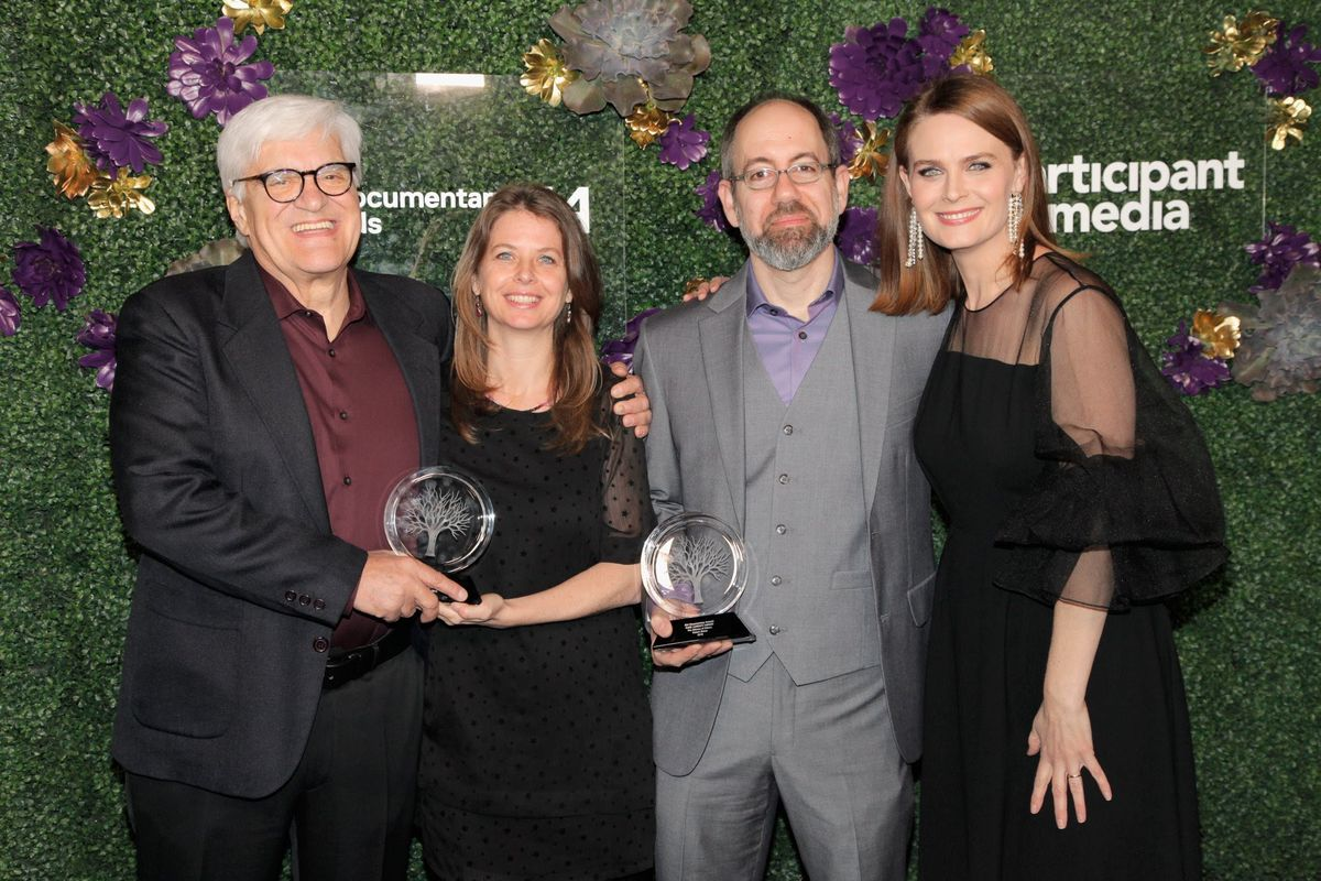 At the 2018 IDA Documentary Awards, left to right: Jose Marie 'Chato' Galante, Almudena Carracedo, Robert Bahar, presenter Emily Deschanel. Photo: Tibrina Hobson