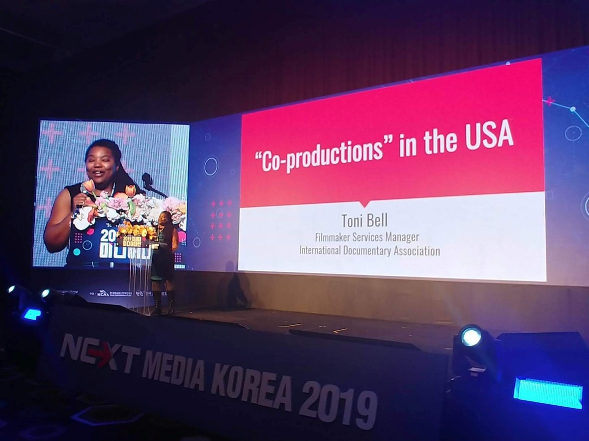 Toni Bell delivering a presentation at Korea Next Media Group.