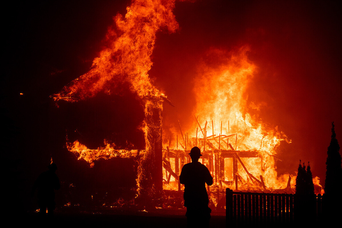 A home burns as the Camp Fire rages through Paradise, CA. Fomr Ron Howard's 'Rebuilding Paradise.' Photo: Noah Berger. Courtesy of National Geographic