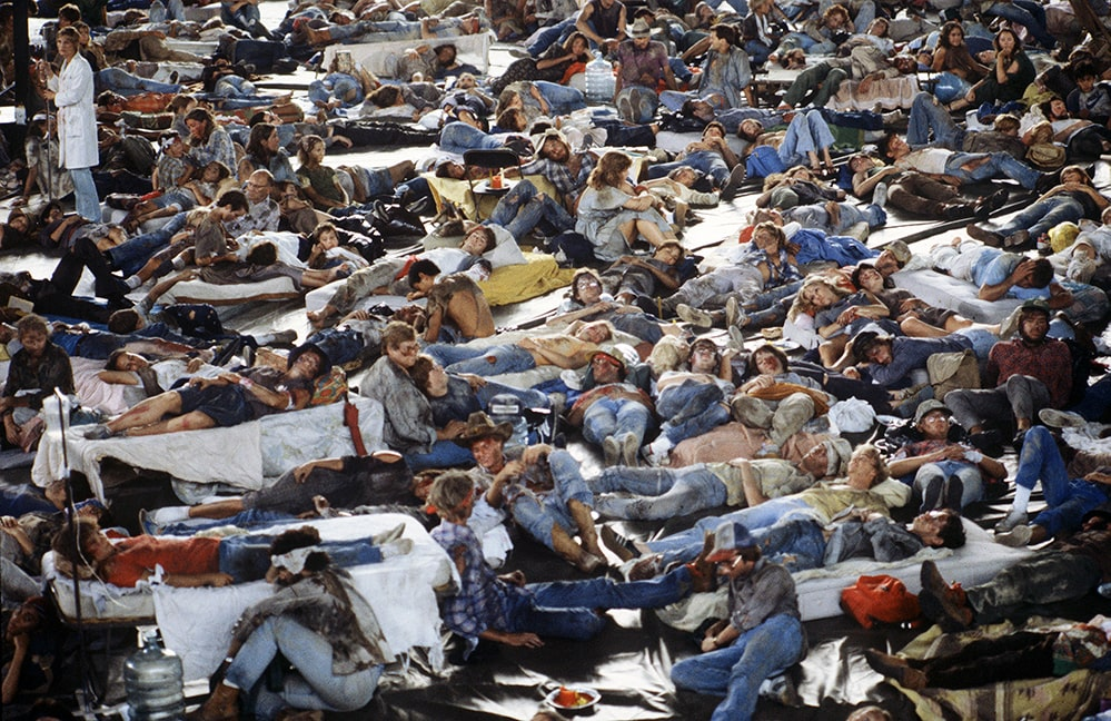 """A crowd of injured people lying on the floor and mattresses. Still from 'The Day After' (1983), as seen in 'Television Event,' directed by Jeff Daniels, where doctors and nurses at a Kansas City hospital grimly witness the start of """"World War III"""", and anticipate being overwhelmed with patients while coping with no power, water or food. Courtesy of Getty Images."""