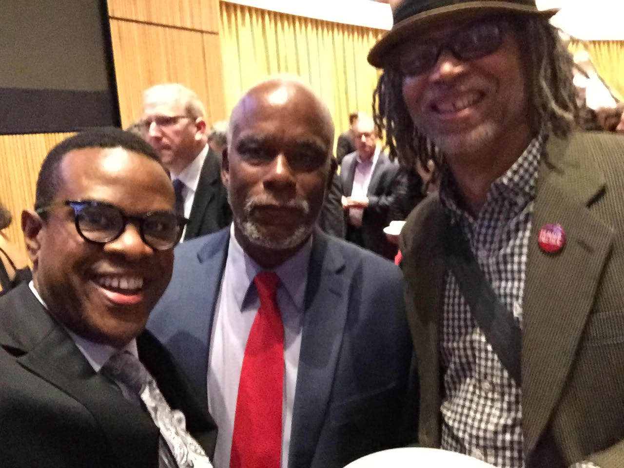 (L-R): Thomas Allen Harris, Stanley Nelson, Lewis Erskine at the 2016 Emmy Awards. They are posing for a selfie. Courtesy of Thomas Allen Harris.