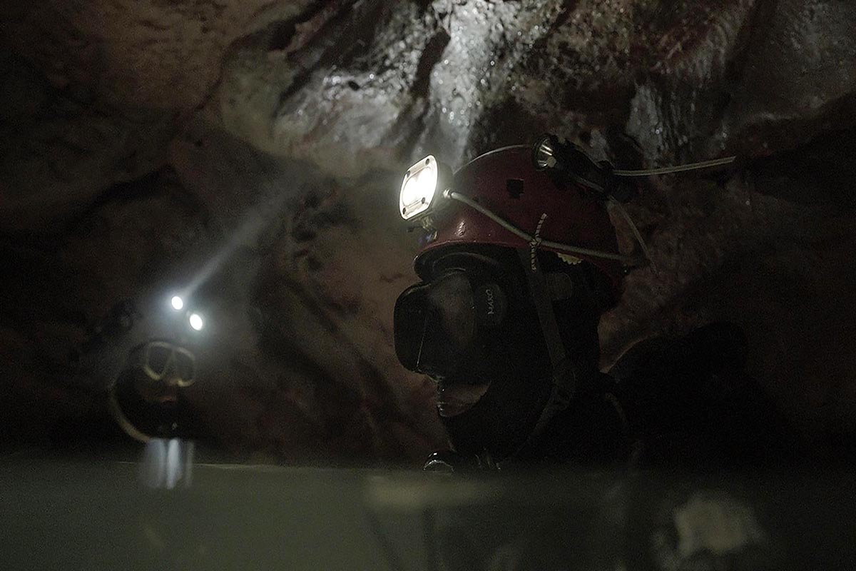 Two cave divers with their headlamps inside a cave. From Chai Vasarhelyi and Jimmy Chin's 'The Rescue.' Credit: National Geographic