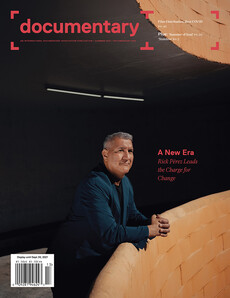 Cover of magazine feat. Rick Perez, a brown-skin toned man leaning against an orange ledge