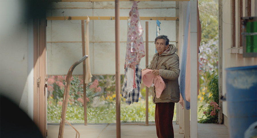 Marta caught stealing from the clothesline; from Maite Alberdi's 'The Mole Agent'. Courtesy of Gravitas Ventures