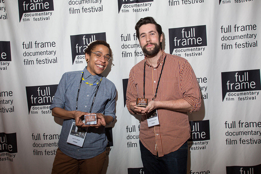 Lyric R. Cabral and David Felix Sutcliffe, with their Grand Jury Award for their film '(T)ERROR.' Courtesy of Full Frame Documentary Film Festival