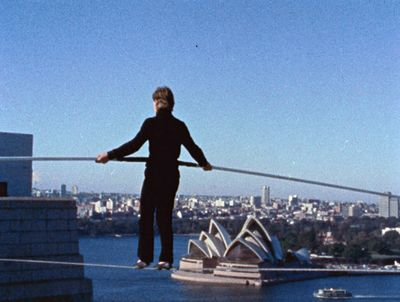 Philip Petit, walking acorss the Sydney Harbour Bridge, in preparation for his transcendent World Tarde Center walk. From James Marsh's Man on Wire. Courtesy of Magnolia Pictures.