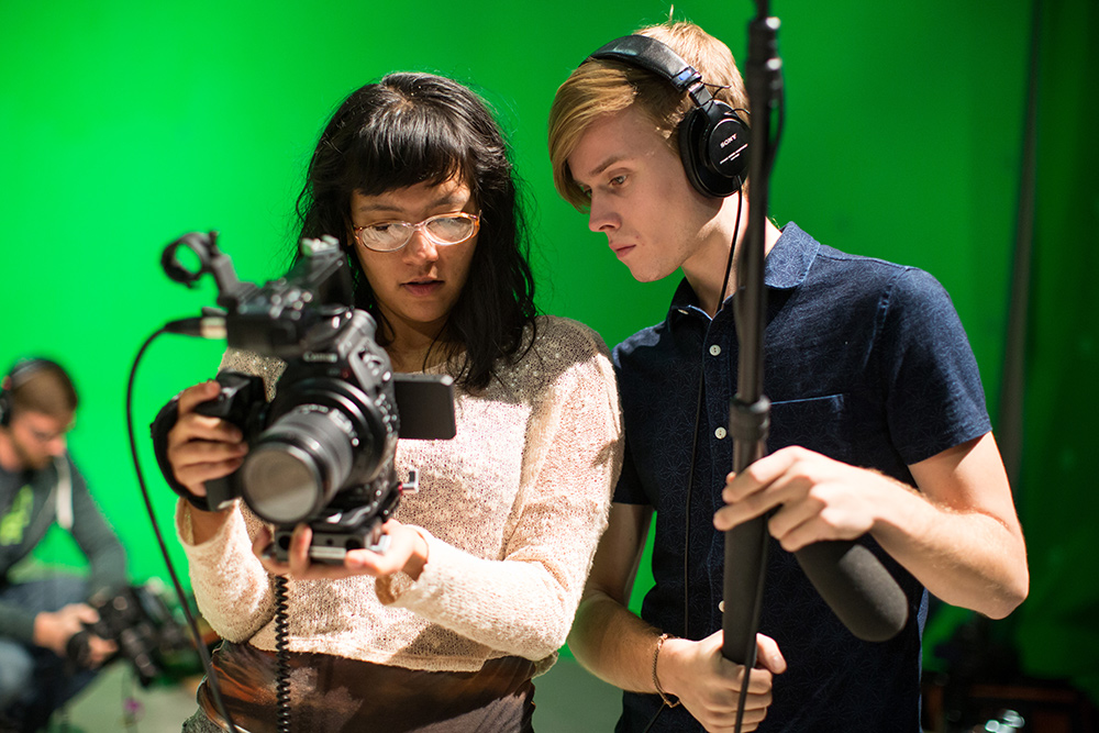 Northwestern MFA in Documentary Media students Miasarah Lai and João Pedro Queriroga review their footage. Photo: Justin Barbin