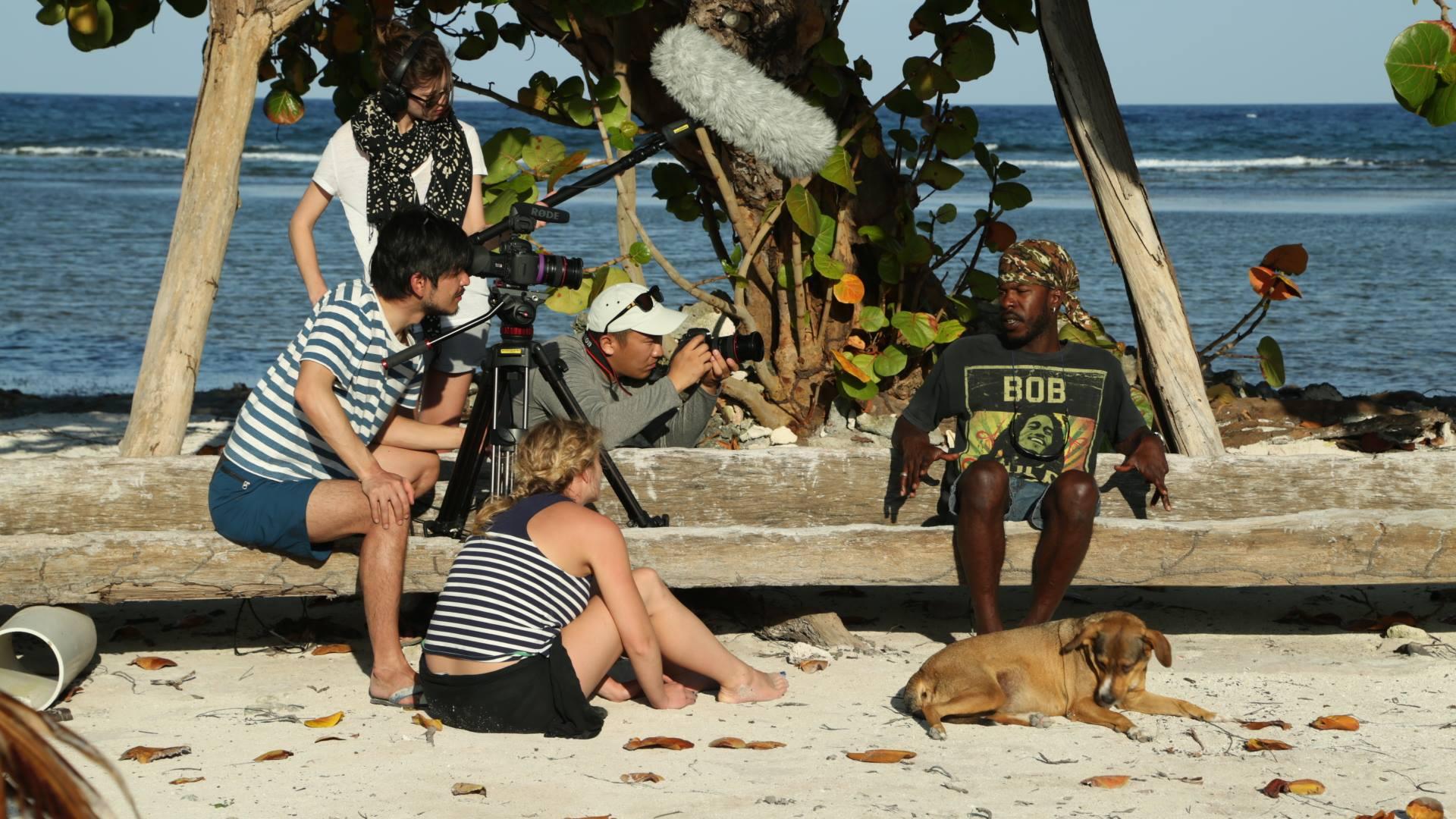 Yusaku Kanagawa, Nina Thomas, Lara-Ann de Wet, and Mingi Kim Interviewing Alton Jeffers in Belize. Photo by Eliana Alvarez. Courtesy of NYFA