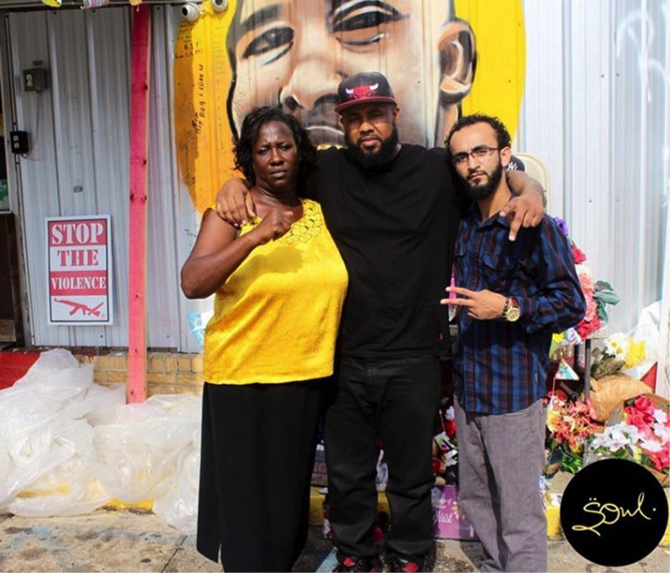 Alton Sterling's aunt Veda Washington, Chris LeDay, and Abdullah Muflahi, in front of a memorial to Sterling.