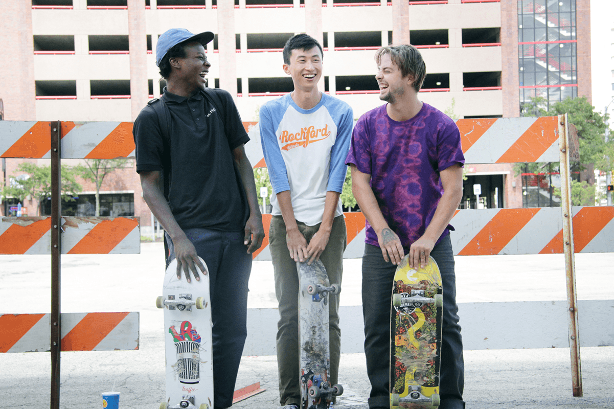 Bing Liu (center), flanked by his protagonists from Minding the Gap, Kiere and Zack.