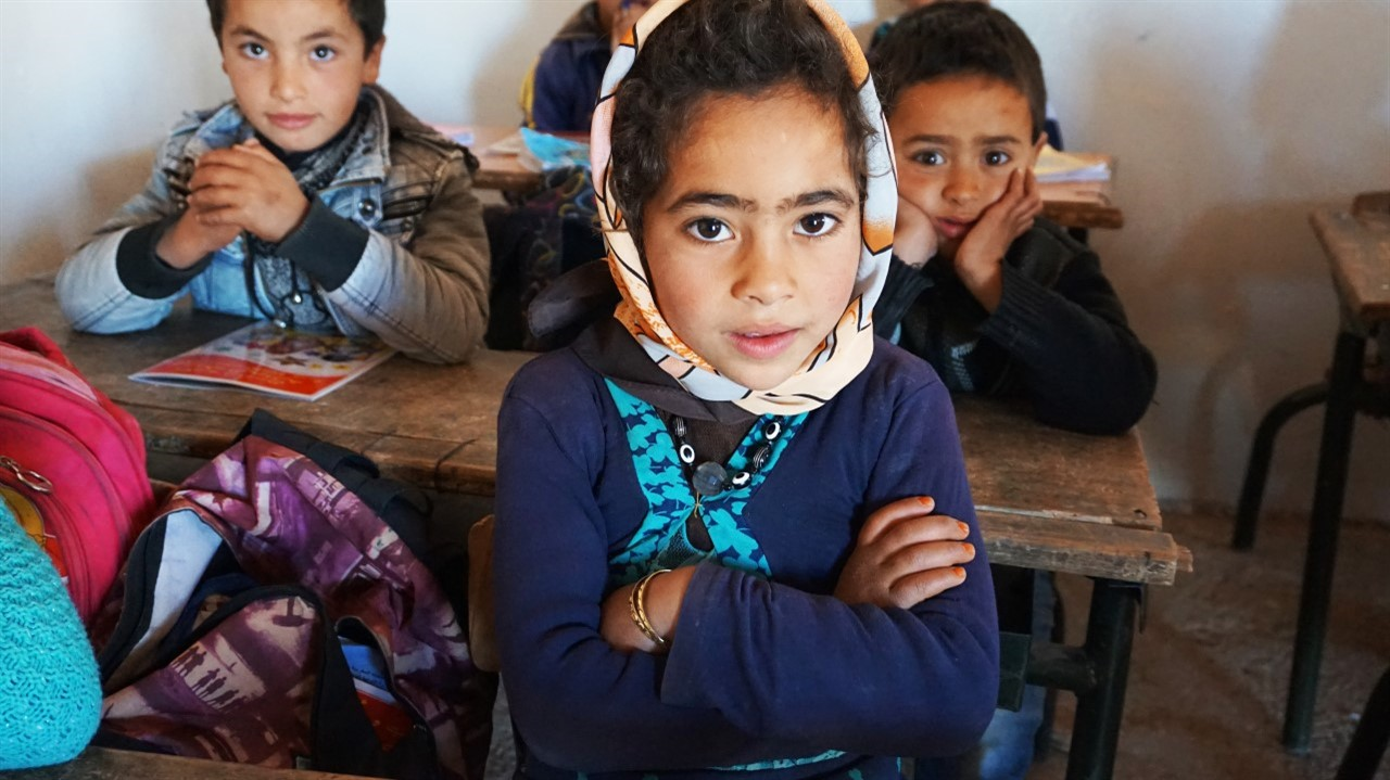 A group of Indigenous Moroccan school children sit at their desks in a classroom. From Mohamed El Boudi's 'School of Hope.' Courtesy of Hot Docs.