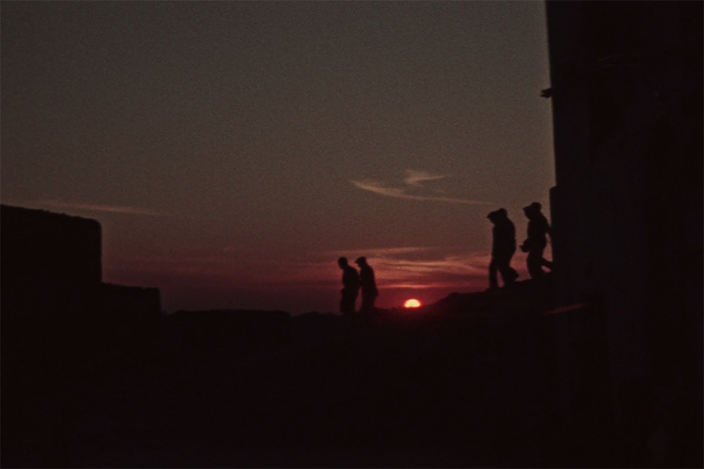 Silhouettes of six men against a setting sun. Image from Vittorio de Seta's 'Solfatara.' Courtesy of The Criterion Collection.
