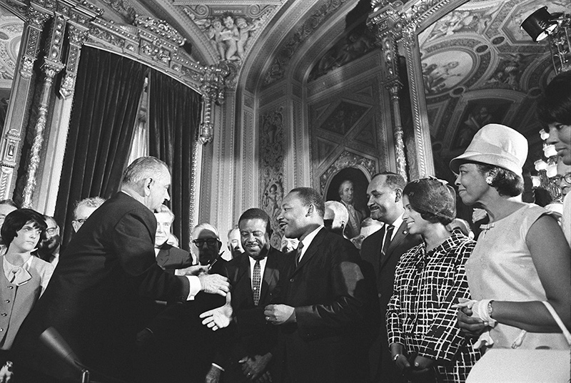 President Lyndon B. Johnson meets with Martin Luther King, Jr. at the signing of the Voting Rights Act of 1965. Photo by  Yoichi Okamoto. Public Domain.
