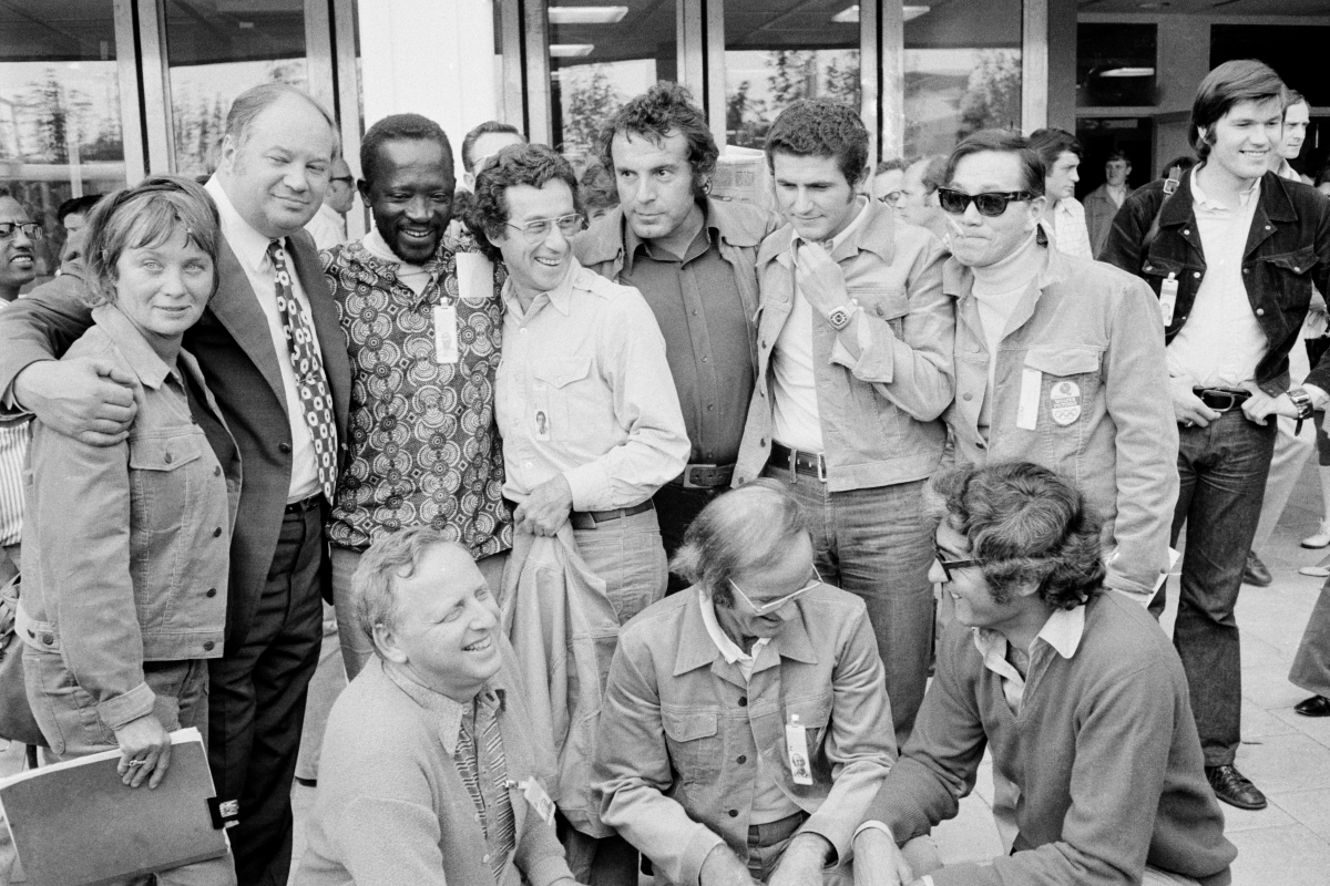 The directors and producers of 'Visions of Eight.'Standing, left to right, Mai Zetterling, Yuri Ozerov, Ousame Sembele, Arthur Penn, Milos Fforman, Claude Lelouch, Kon Ichikawa. Crouching, left to right: David Wolper, Stan Marguiles and Michael Pfleghaar. Courtesy of The Criterion Collection