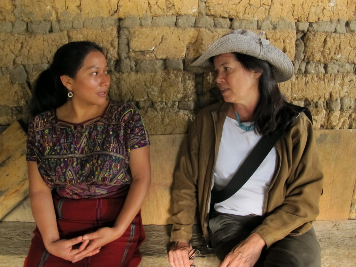 "Matilde Terraza and Pamela Yates discuss the filming of ""500 Years""  with her family in Nebaj, Guatemala. (photo: Skylight Pictures)"