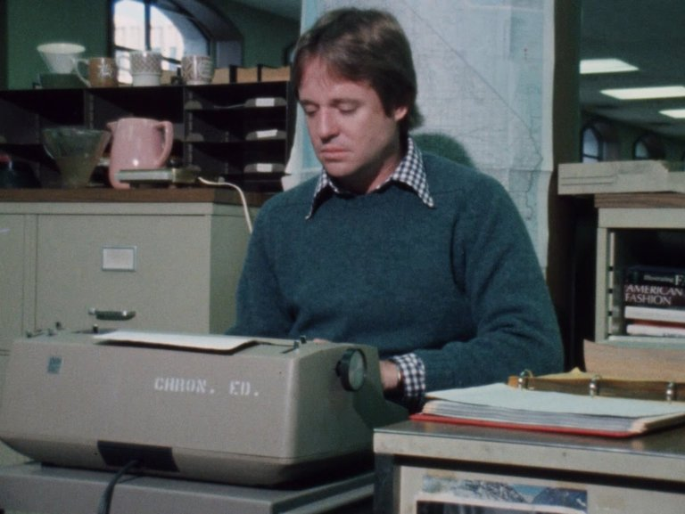 Armistead Maupin at a typewriter at The San Francisco Chronicle, as seen in 'The Untold Tales of Armistead Maupin.' Credit: KQED.