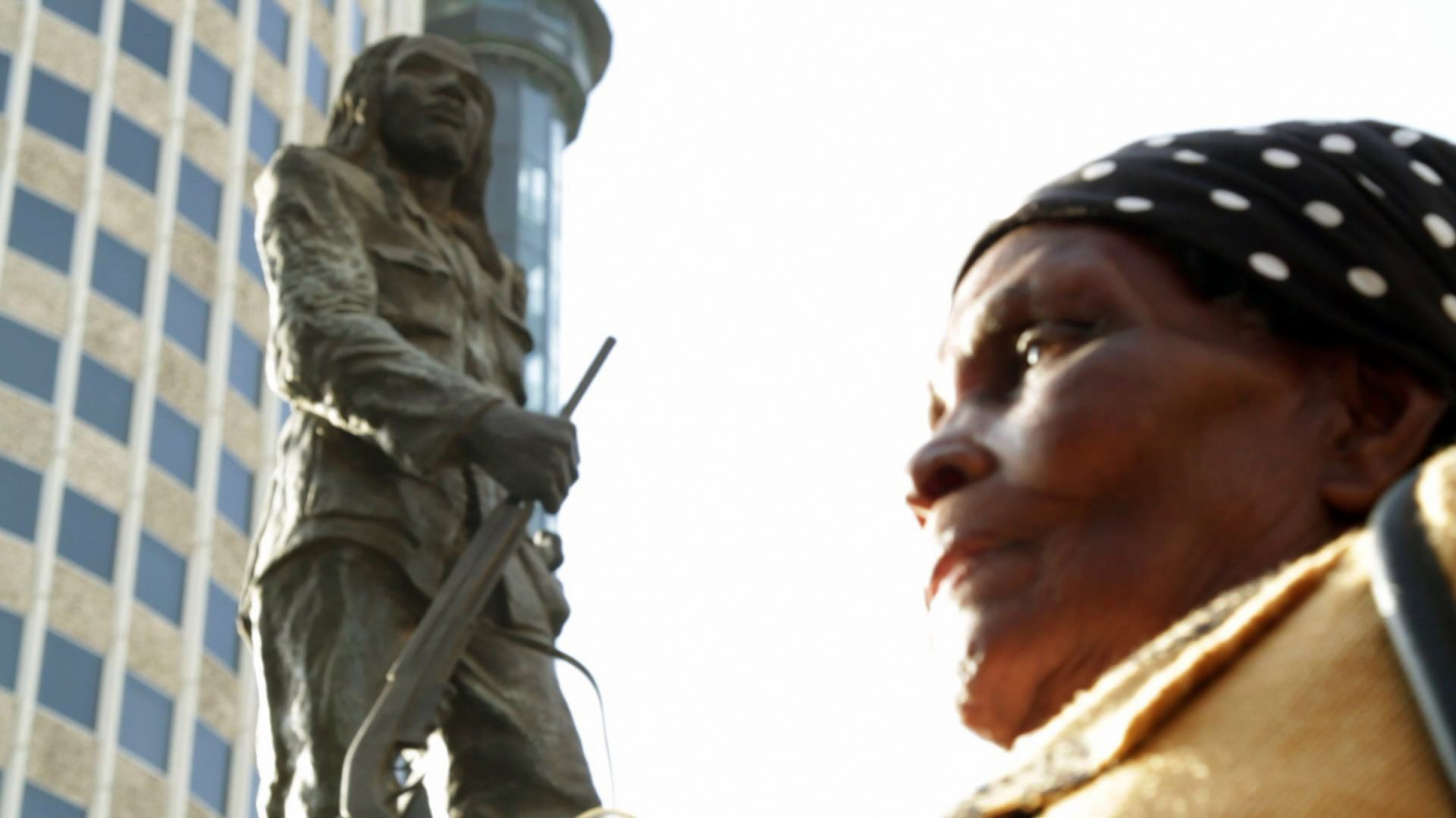 Still from Meena Nanji and Zippy Kimundu's 'Testament' depicting the film's protagonist in front of the statue of Dedan Kimathi, located in Nairobi.