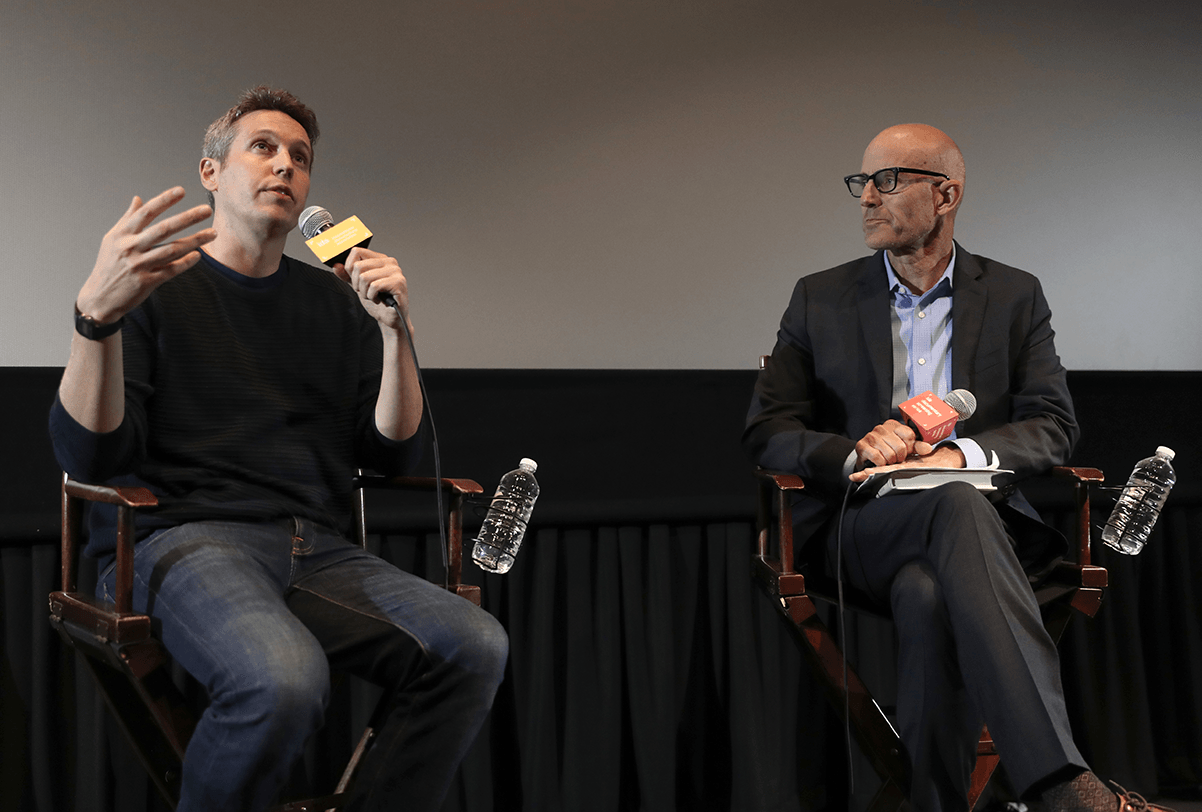 "Tim Wardle (left), director of ""Three Identical Strangers,"" speaking with KPCC's John Horn at the IDA Screening Series. Photo by Todd Hayes."