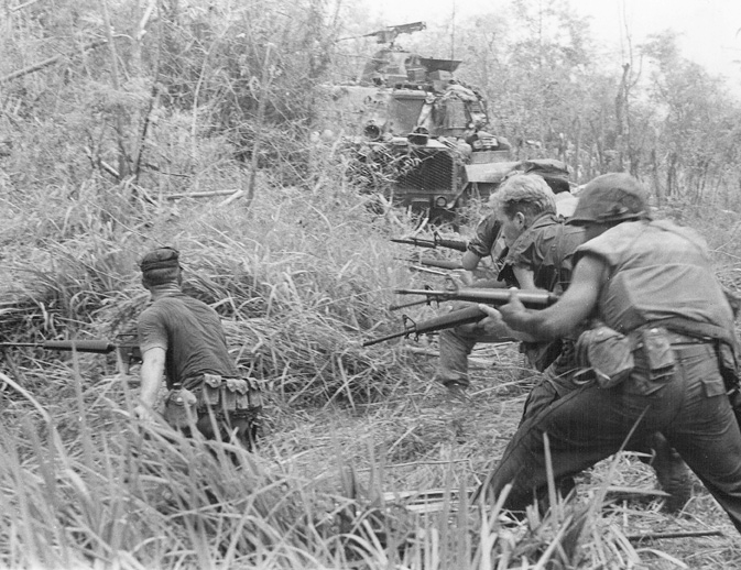 US Marines with Company G, 2d Battalion, 7th Marines, direct a concentration of fire at the enemy during the Vietnam War, May 1968. Photo courtesy of US Marines.