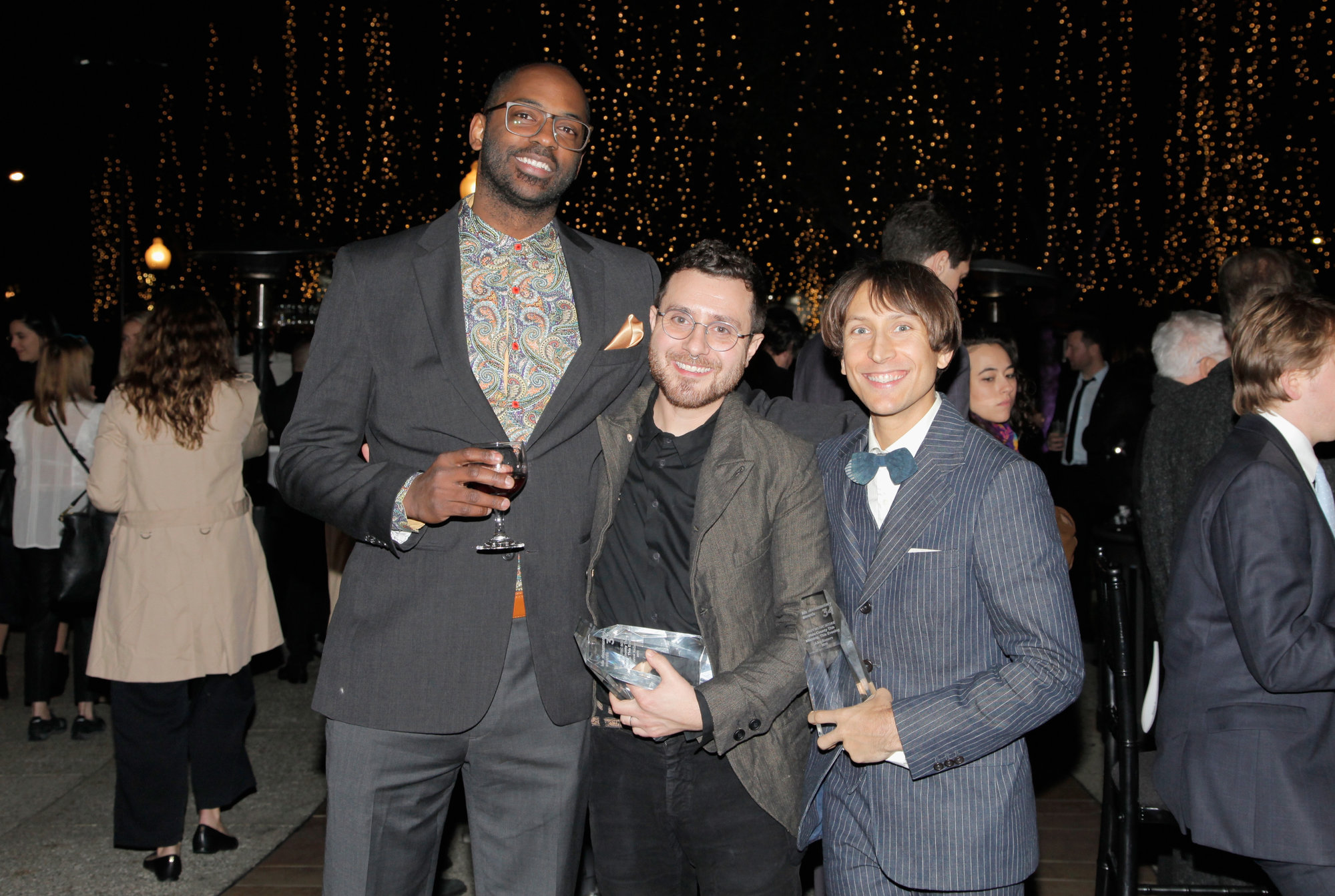 Left to right: Composers Alex Somers and Scott Alario and RaMell Ross at the IDA Documentary Awards. Photo by Tibrina Hobson.