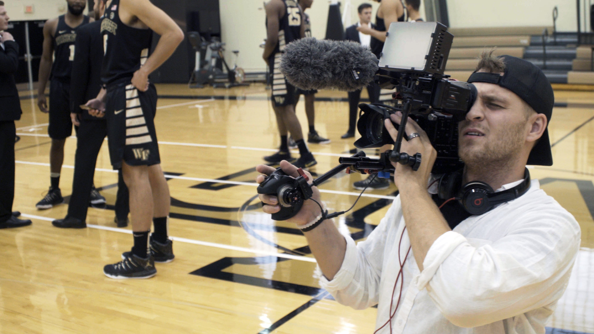 DFP student Oliver Rouch (MFA '18) working with the Wake Forest basketball team. Photo courtesy of Documentary Film Program.