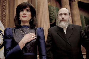 A jewish couple, the wife is being sworn in as the judge inside a courthouse
