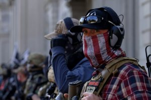 2 far-right extremists, dressed in flannel shirts, bullet-proof vests and baseball caps, outside the US Capitol on January 6.